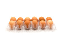 Studio Shot Plastic Egg Box With Dozen Of Large Brown Eggs Isolated On White