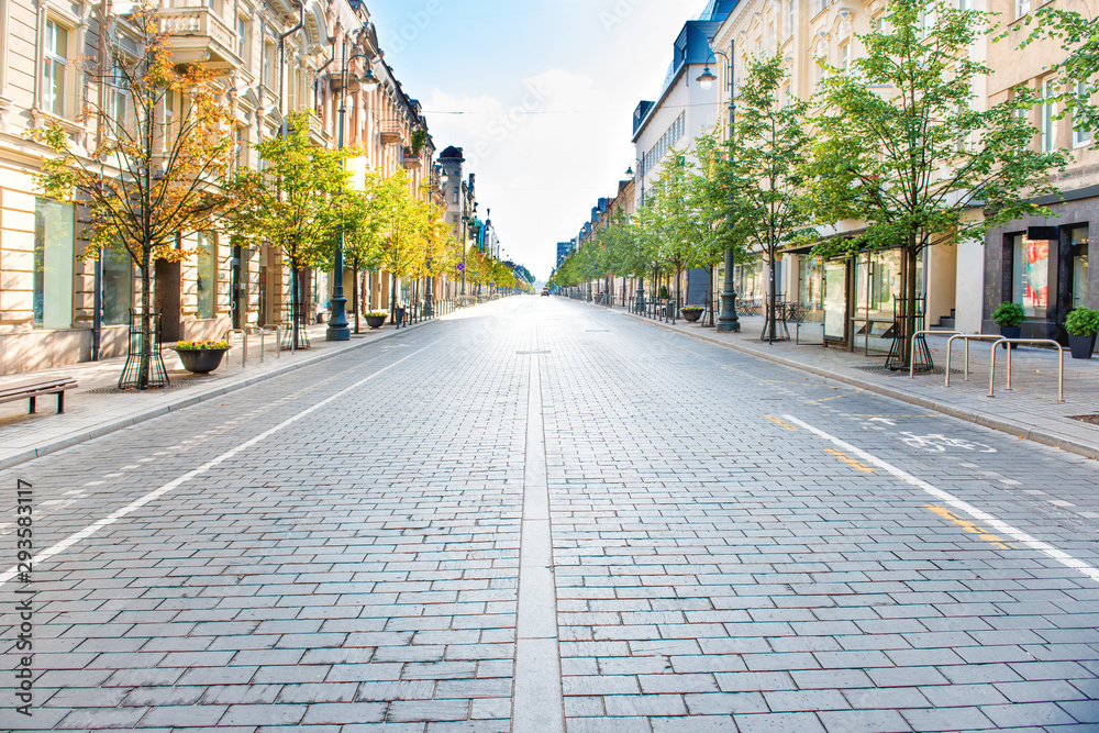 Fototapeta City street with empty road and morning light in Europe, Lithuania, Vilnius