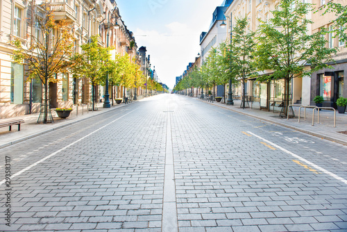 City street with empty road and morning light in Europe, Lithuania, Vilnius - 293583117
