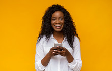 Happy African American Girl Using Her Smartphone