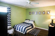 Green Room Of Boy Child Teenager With Navy Striped Bedding And Curtains And Rug