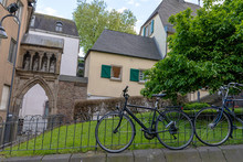 Bicycle Stands Near The Wall Of An Old House In The Old City Of Europe