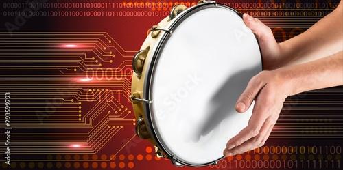 Obraz na płótnie Female hands Playing the tambourine on background