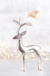 canvas print picture Christmas reindeer on bokeh silver background. Christmas or New Year minimal concept.