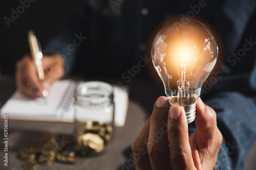 Photo Hand of male holding a light bulb and copy space for accounting, ideas and creative concept