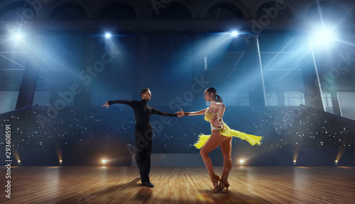 Couple dancers  perform latin dance on large professional stage. Ballroom dancing. - 293608591