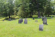 Hilly Cemetery In Maine With Old Grave Stones