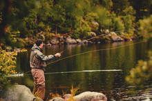 Coil Of Fly Fishing Rope, Man Hands Holding Rod