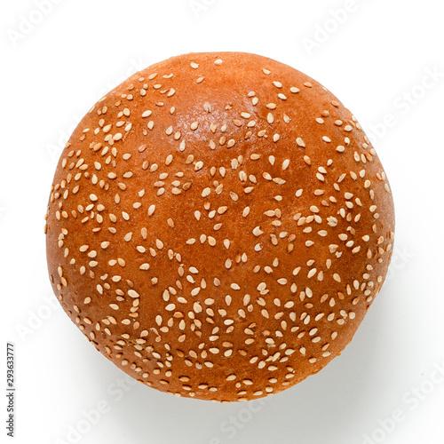 Fototapeta Sesame seed hamburger bun isolated on white. Top view. obraz
