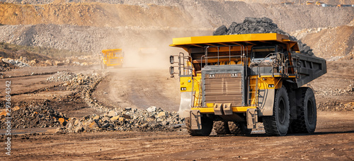 Fototapeta Open pit mine industry, big yellow mining truck for coal anthracite