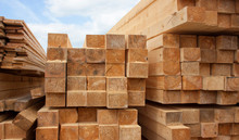 Lumber Warehouse. Wood Planks And Timber Stacked In Stacks Outdoors