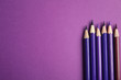 Leinwanddruck Bild - Flat lay composition with color pencils on purple background. Space for text