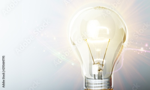 Photo  Glowing yellow light bulb, busienss idea concept