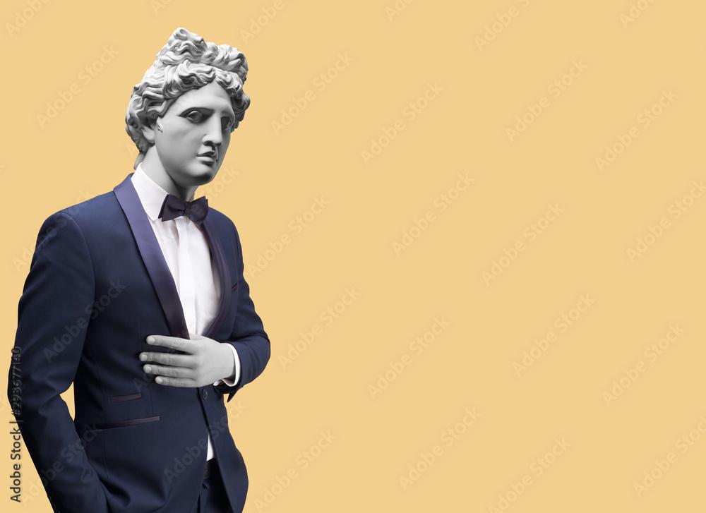 Fototapeta Modern art collage. Concept portrait of handsome stylish man in elegant blue suit .Gypsum head of of Apollo. Man in suit.