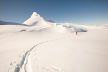 Skier In The Distance On A Backcountry Hut Trip In British Columbia, Canada.