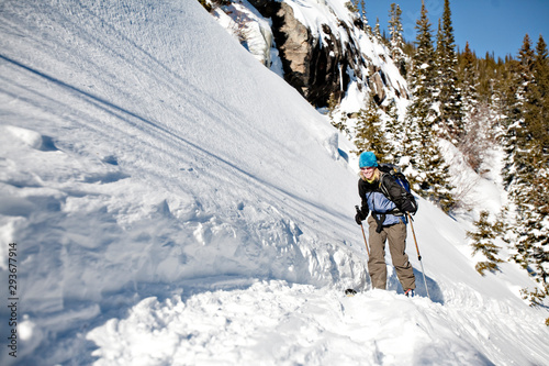 Woman backcountry skiing in Rocky Mountain National Park on a sunny spring day.