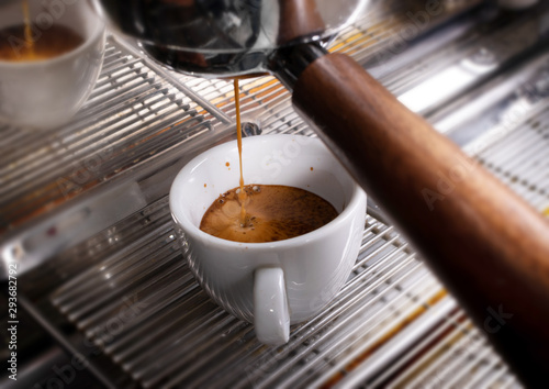 фотография Making espresso coffee in coffeeshop or cafe closeup