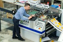 Manworking On Printing Machine...