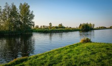 Dutch Scenery With Boats And T...