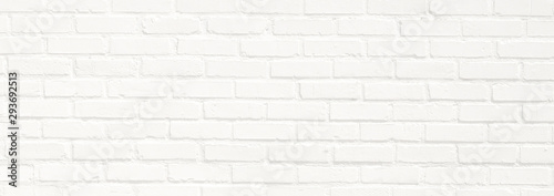 Spoed Fotobehang Baksteen muur White brick wall background. Neutral texture of a flat brick wall close-up.