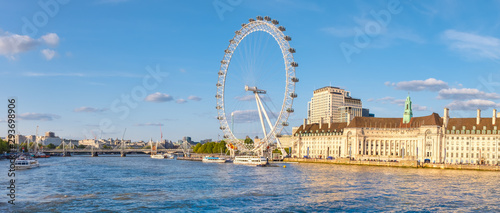 Fototapeta The river Thames, the Southbank and the London Eye at sunset