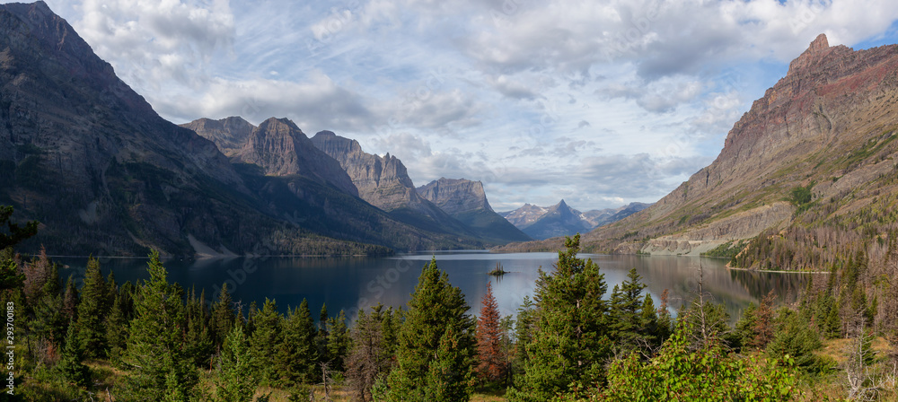 Fototapety, obrazy: Beautiful Panoramic View of a Glacier Lake with American Rocky Mountain Landscape in the background during a Cloudy Summer Morning. Taken in Glacier National Park, Montana, United States.