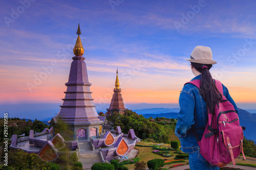 Foto auf AluDibond Aubergine lila Travelers looking at Landscape of two big pagoda on the top of Doi Inthanon mountain, Chiang Mai, Thailand.