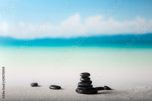 Staande foto Stenen in het Zand Stack of zen stones on sand beach