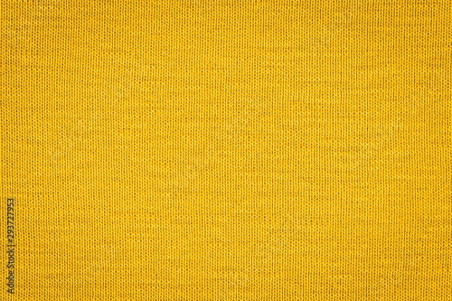 Fotografiet  Texture of real yellow knitwear, textile background