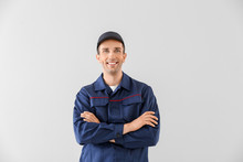 Male Car Mechanic On Light Background