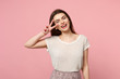 canvas print picture - Laughing young woman in casual light clothes posing isolated on pastel pink wall background, studio portrait. People sincere emotions lifestyle concept. Mock up copy space. Showing victory sign.