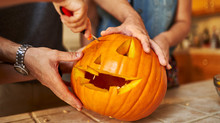 Close Up Of Carving Pumpkin For Halloween