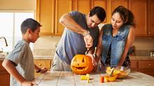 Halloween Activity - Family Carving Pumpkin Into Jack-o-lantern