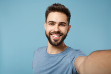 Close Up Young Smiling Man In Casual Clothes Posing Isolated On Blue Wall Background, Studio Portrait. People Sincere Emotions Lifestyle Concept. Mock Up Copy Space. Doing Selfie Shot On Mobile Phone.