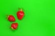canvas print picture - Ripe strawberries on bright green background. Healthy eating