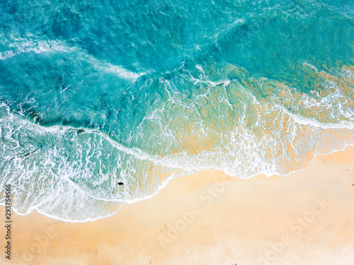 Top view of blue aqua sea water. Capture by drone. Capture sea wave and beach in summer by drone.