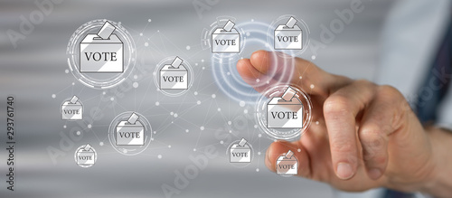 Man touching an online voting concept