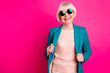 Leinwandbild Motiv Portrait of her she nice-looking attractive cheerful cheery gray-haired lady wearing blue green jacket enjoying life lifestyle isolated on bright vivid shine vibrant pink fuchsia color background