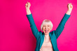 canvas print picture - Portrait of her she nice attractive cheerful cheery overjoyed gray-haired lady wearing blue green jacket rejoicing rising hands up isolated on bright vivid shine vibrant pink fuchsia color background