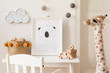 canvas print picture - Modern and design scandinavian interior of kidroom with white desk, armachir, mock up poster frame, natural basket, toys, teddy bear, plush toys and cute children's accessories. Stylish home decor.