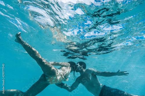 Fototapeta woman snorkeling in the sea