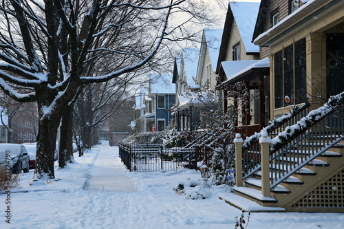 Fresh snow covers the sidewalk in a residential neighborhood of Chicago