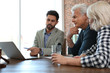 canvas print picture - Male notary working with mature couple in office