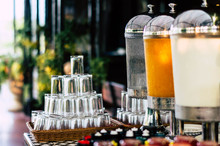 Drinking Water, Orange Juice And Milk Dispenser For Guests At The Hotel