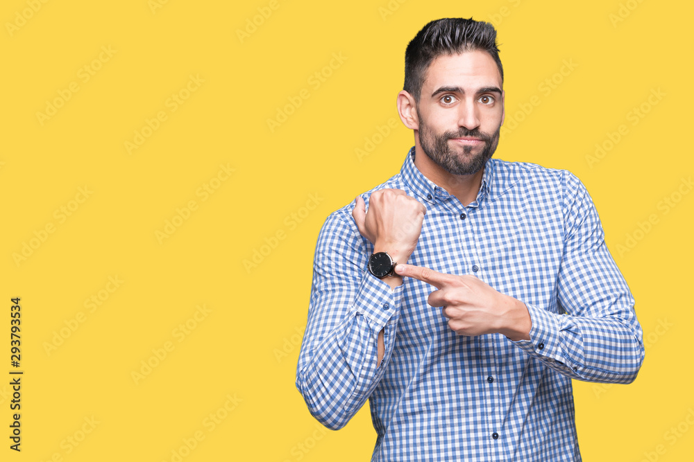 Fototapety, obrazy: Young handsome man over isolated background In hurry pointing to watch time, impatience, upset and angry for deadline delay