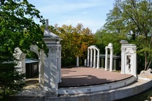Classical Amphitheater In Royal Baths (polish: Lazienki Park). Ancient Theater On Island In Royal Baths. Stage On The Isle. Warsaw, Poland