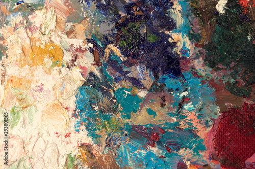 Background image of bright oil-paint palette closeup.