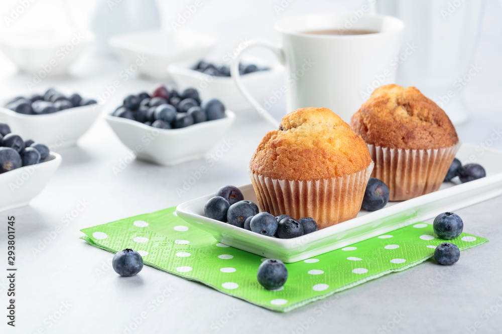 Fototapety, obrazy: Muffins and blueberry on white table.