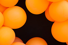 Festive Composition With Bunch Of Matte Orange Balloons. Macro Shot, Close Up, Background With A Lot Of Copy Space For Text.