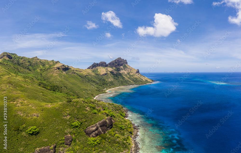 Fototapeta Wild coast of the tropical Waya island in the Yasawa islands group in Fiji in the south Pacific ocean.